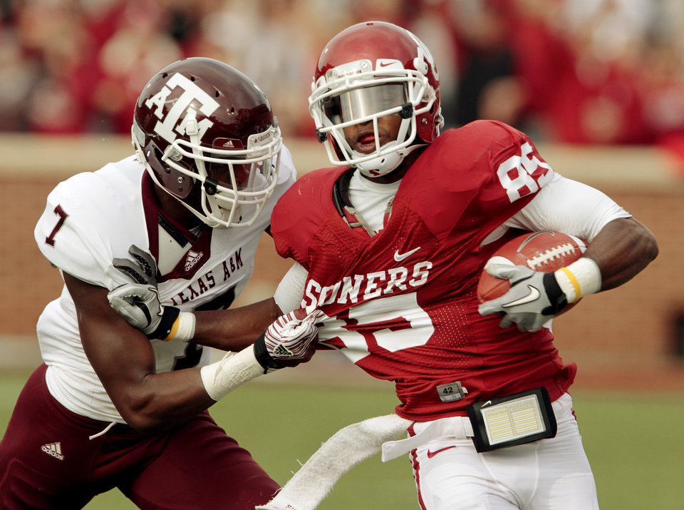 Ryan Broyles  tries to avoid Texas A&M's Terrence Frederick (7) during the first half of the college football game between the Texas A&M Aggies and the University of Oklahoma Sooners (OU) at Gaylord Family-Oklahoma Memorial Stadium on Saturday, Nov. 5, 2011, in Norman, Okla. Photo by Steve Sisney, The Oklahoman