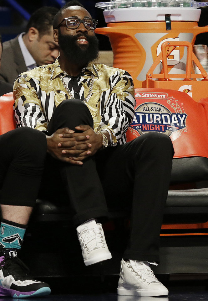 Photo - Houston Rockets' James Harden watches play during the skills competition at the NBA All Star basketball game, Saturday, Feb. 15, 2014, in New Orleans. (AP Photo/Gerald Herbert)
