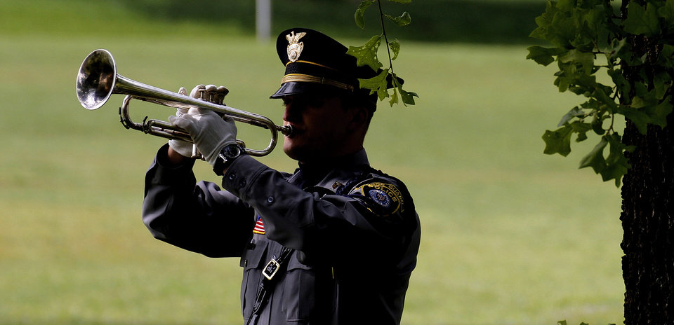 Oklahoma City Police Sgt. Corey Carden plays taps during the Oklahoma Law Enforcement Officers Memorial Service in Oklahoma City , Friday, May 10, 2013. Photo By Steve Gooch, The Oklahoman