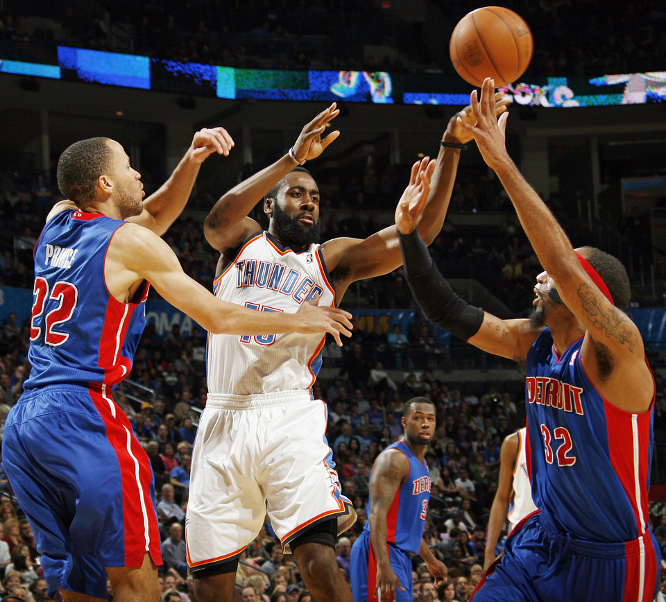 Oklahoma City's James Harden (13) passes the ball between Tayshaun Prince (22) and Richard Hamilton (32) of Detroit during an NBA basketball game between the Oklahoma  City Thunder and the Detroit Pistons at the OKC Arena in Oklahoma City, Friday, March 11, 2011.  Oklahoma City won, 104-94. Photo by Nate Billings, The Oklahoman