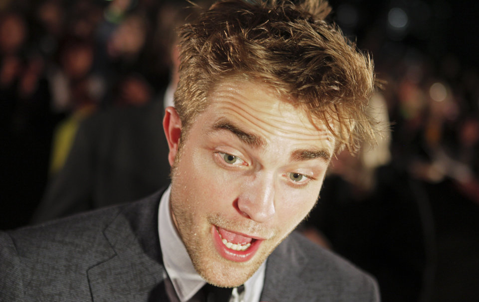 British actor Robert Pattinson talks with the media before a film premiere of 'Twilight Breaking Dawn Part 1' in Barcelona, Spain, Thursday, Nov. 17, 2011.  (AP Photo  / Job Vermeulen)  ORG XMIT: MF120