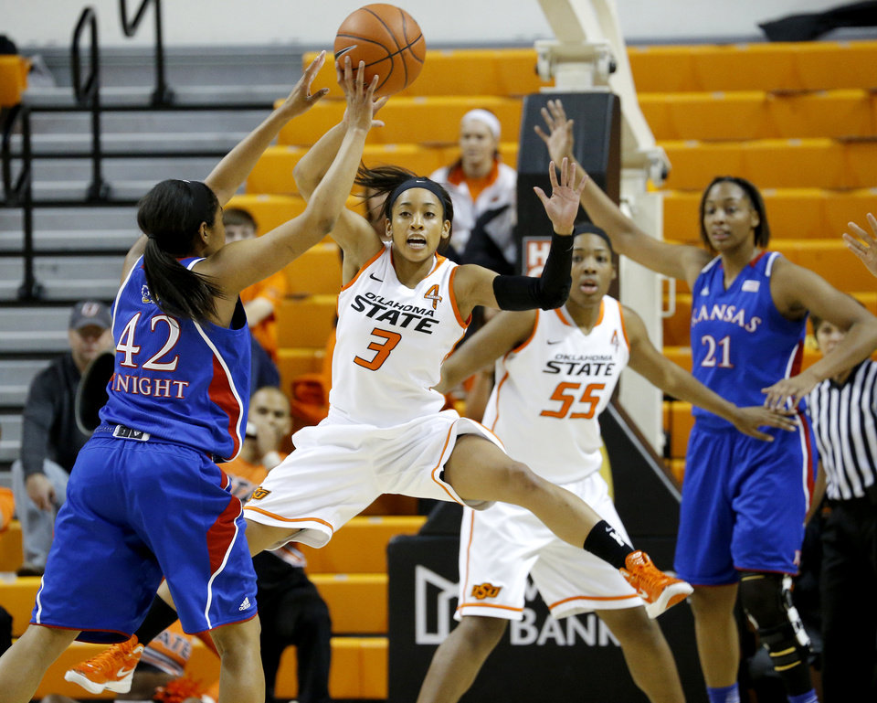 Photo - Kansas' Natalie Knight (42) passes the ball around Oklahoma State's Tiffany Bias (3) during a women's college basketball game between Oklahoma State University (OSU) and Kansas at Gallagher-Iba Arena in Stillwater, Okla., Tuesday, Jan. 8, 2013. Photo by Bryan Terry, The Oklahoman