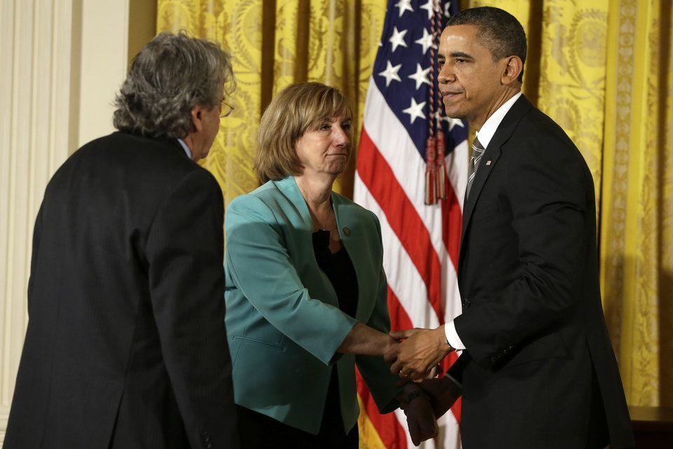 President Barack Obama greets the parents of Sandy Hook Elementary School teacher Lauren Rousseau, Terry and Gilles Rousseau, Friday, Feb. 15, 2013, in the East Room of the White House in Washington, before presenting them with a 2012 Citizens Medal.  (AP Photo/Jacquelyn Martin)