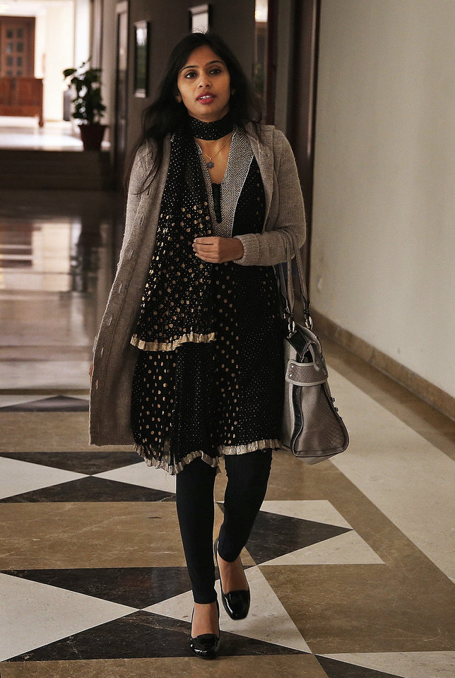 Photo - Devyani Khobragade, who served as India's deputy consul general in New York, leaves Maharastra Sadan state house in New Delhi, India, Saturday, Jan. 11, 2014. Khobragade, 39, is accused of exploiting her Indian-born housekeeper and nanny, allegedly having her work more than 100 hours a week for low pay and lying about it on a visa form. Khobragade has maintained her innocence, and Indian officials have described her treatment as barbaric. (AP Photo/Saurabh Das)