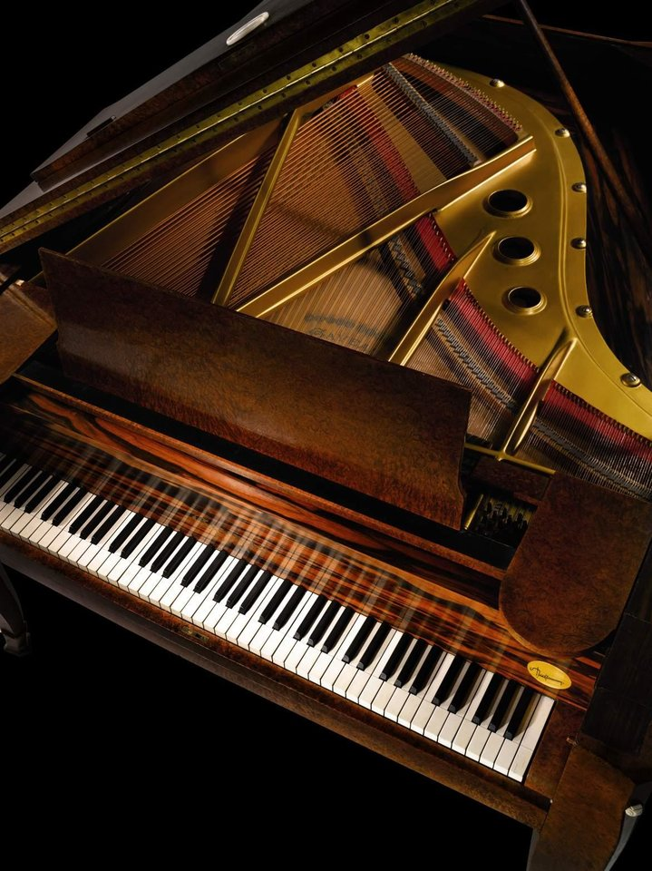 Photo - This undated image provided by Sotheby's auction house shows a Emile-Jacques Ruhlmann art deco grand piano that will be up for auction in March. The piano sailed aboard the French ocean liner Normandie in the 1930s and was purchased by the Butler family of Buffalo in the early 1940s. (AP Photo/Sotheby's)