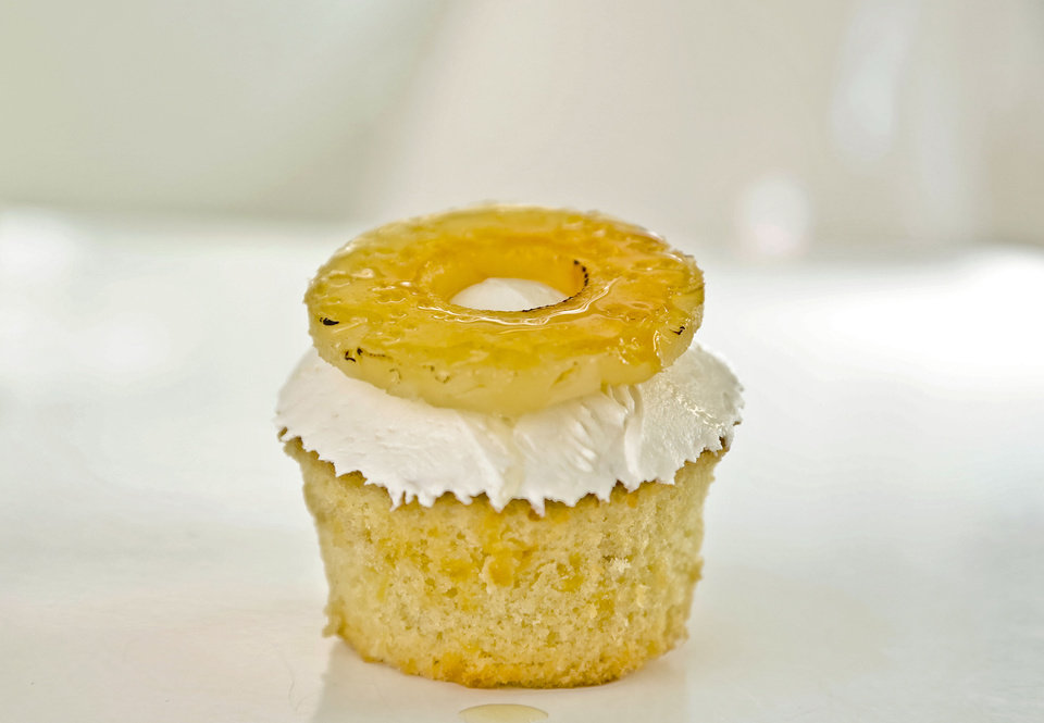 Photo - A pineapple upside-down cupcake from Sara Sara Cupcakes.  CHRIS LANDSBERGER - CHRIS LANDSBERGER