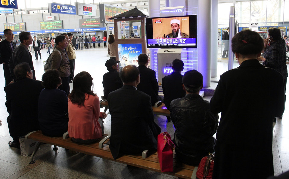 Photo - South Koreans watch a TV broadcasting a report about Osama bin Laden, at Seoul train station in Seoul, South Korea, Monday, May 2, 2011. Osama bin Laden, the glowering mastermind behind the Sept. 11, 2001, terror attacks that murdered thousands of Americans, was killed in an operation led by the United States, President Barack Obama said Sunday. The Korean read