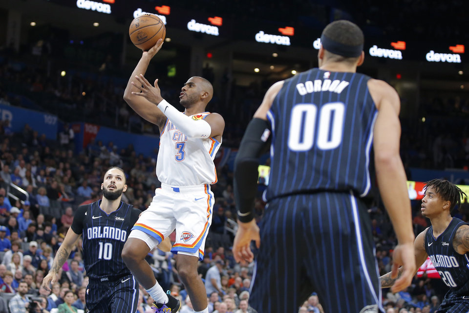 Photo - Oklahoma City's Chris Paul (3) shoots the ball as Orlando's Evan Fournier (10) defends during an NBA basketball game between the Oklahoma City Thunder and the Orlando Magic at Chesapeake Energy Arena in Oklahoma City, Tuesday, Nov. 5, 2019. [Bryan Terry/The Oklahoman]