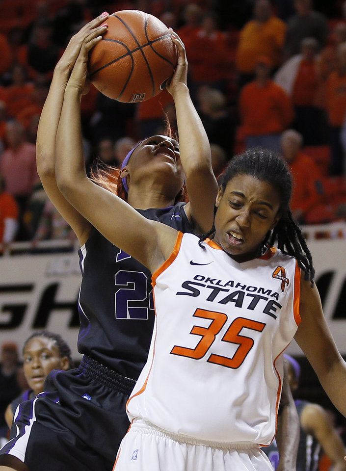 TCU's Natalie Ventress (24) grabs a rebound behind Oklahoma State's Marisha Wallace (25) during a women's NCAA college basketball game between Oklahoma State University (OSU) and TCU at Gallagher-Iba Arena in Stillwater, Okla., Tuesday, Jan. 14, 2014. Oklahoma State won 65-53. Photo by Bryan Terry, The Oklahoman