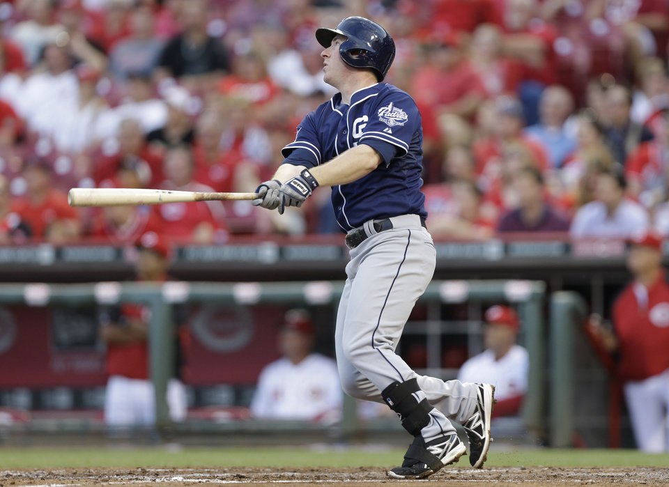 Photo - San Diego Padres' Jedd Gyorko watches his sacrifice fly off Cincinnati Reds starting pitcher Mike Leake that drove in a run in the fourth inning of a baseball game, Tuesday, May 13, 2014, in Cincinnati. (AP Photo)