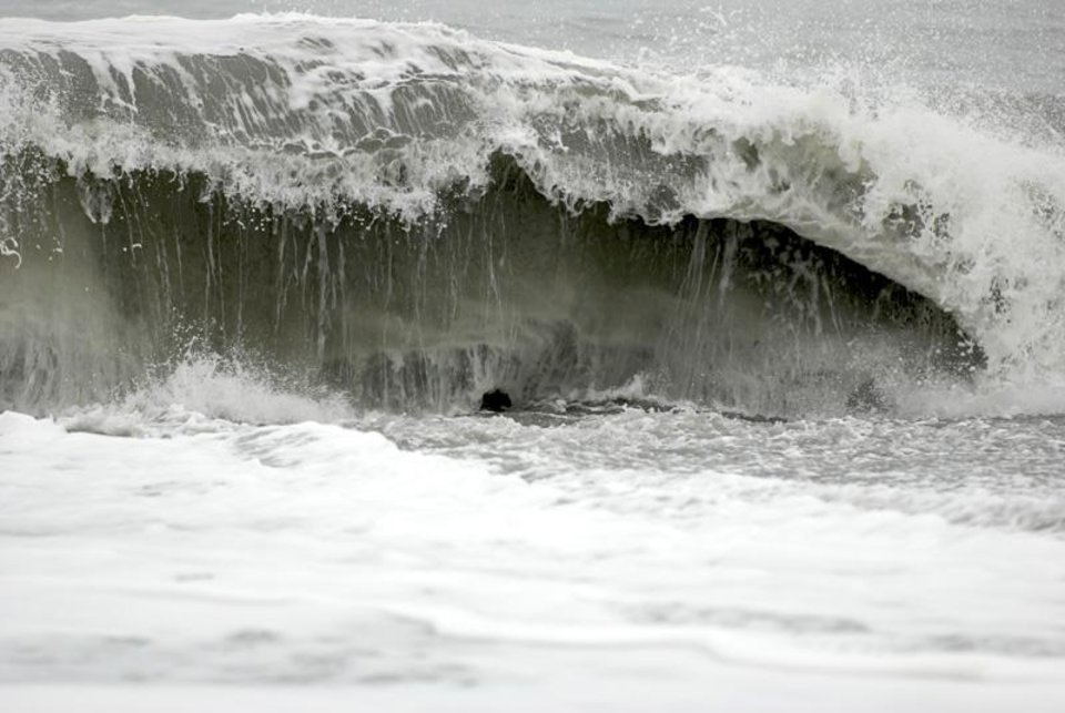 Photo - The surf at Big Lagoon beach creates a moderate undertow on Monday, Nov. 26, 2012 near Trinidad, Calif. A family that tried to rescue their dog from powerful surf at the beach in Northern California were swept out to sea, leaving the parents dead and their 16-year-old son missing, authorities said. (AP Photo/The Times-Standard, Jose Quezada)