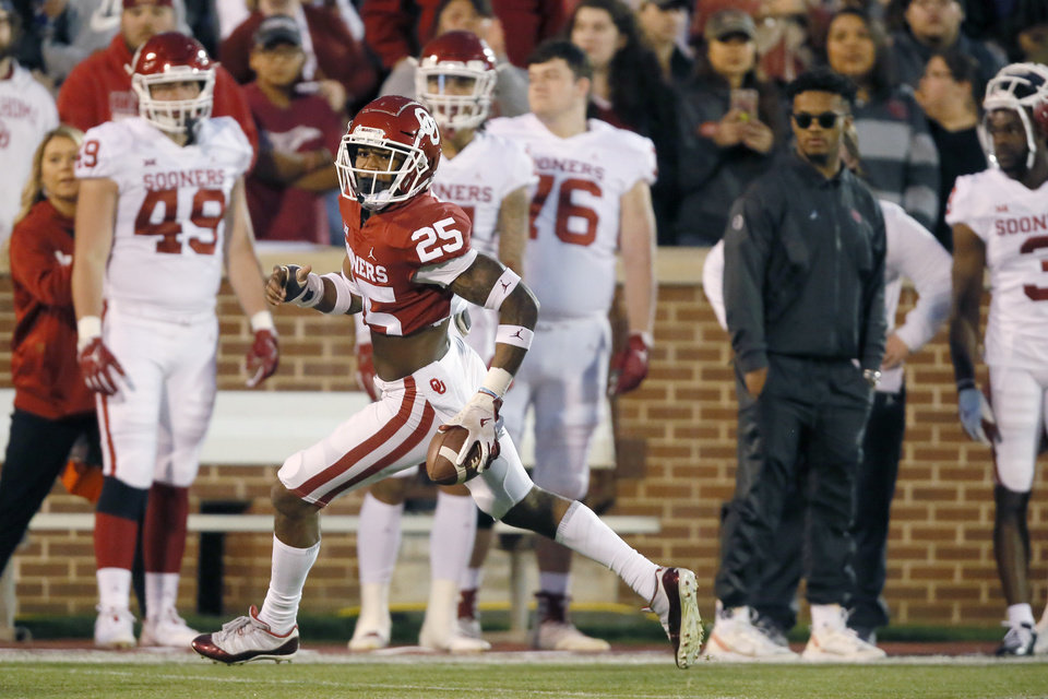 Photo - Oklahoma's Justin Broiles (25) runs back an interception during the University of Oklahoma's (OU) spring football game at Gaylord Family-Oklahoma Memorial Stadium in Norman, Okla., Friday, April 12, 2019. Photo by Bryan Terry, The Oklahoman