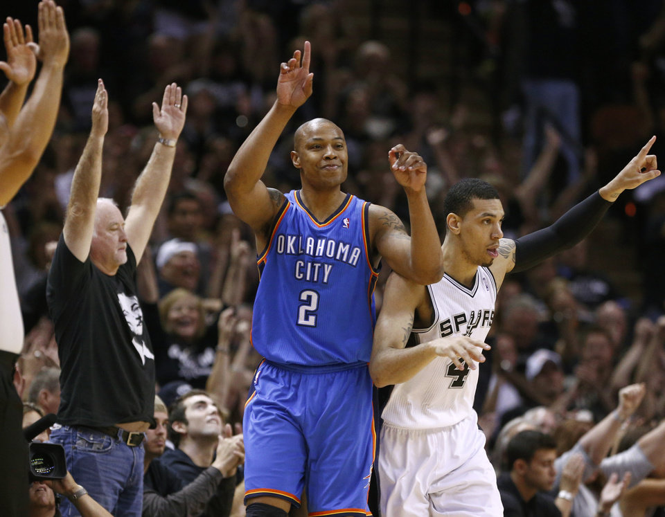 Photo - San Antonio's Danny Green (4) reacts next to Oklahoma City's Caron Butler (2) during Game 1 of the Western Conference Finals in the NBA playoffs between the Oklahoma City Thunder and the San Antonio Spurs at the AT&T Center in San Antonio, Monday, May 19, 2014. Photo by Sarah Phipps, The Oklahoman