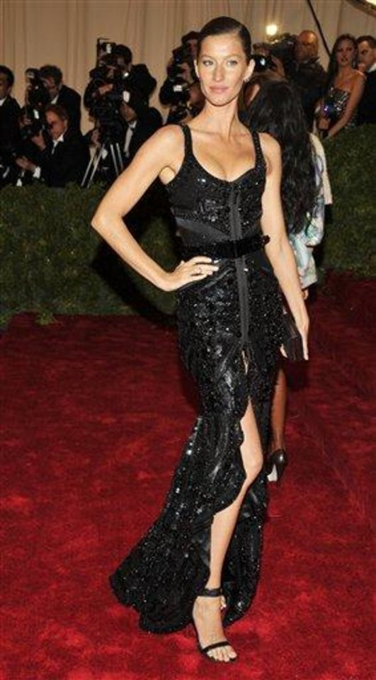 Photo - Gisele Bundchen arrives at the Metropolitan Museum of Art Costume Institute gala benefit, celebrating Elsa Schiaparelli and Miuccia Prada, Monday, May 7, 2012 in New York. (AP Photo/Charles Sykes)
