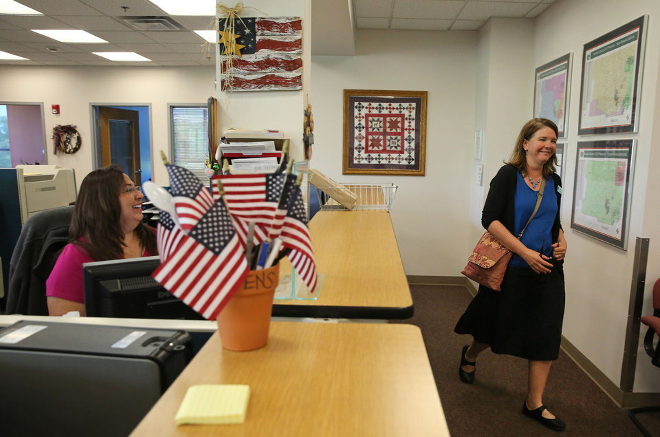 Photo - Boulder County Clerk Hillary Hall, right, is wished well by admin tech Marie Albert, left, as Hall leaves for lunch following a news conference at the offices of the Boulder County Clerk and Recorder, in Boulder, Colo., Thursday, July 10, 2014. District Court Judge Andrew Hartman ruled Thursday July 10 that gay couples can keep getting married in Colorado. The decision by Hartman said that Boulder County Clerk Hall can ignore a federal stay on a ruling from the 10th U.S. Circuit Court of Appeals in Denver, which found states cannot set gender requirements for marriage. (AP Photo/Brennan Linsley)
