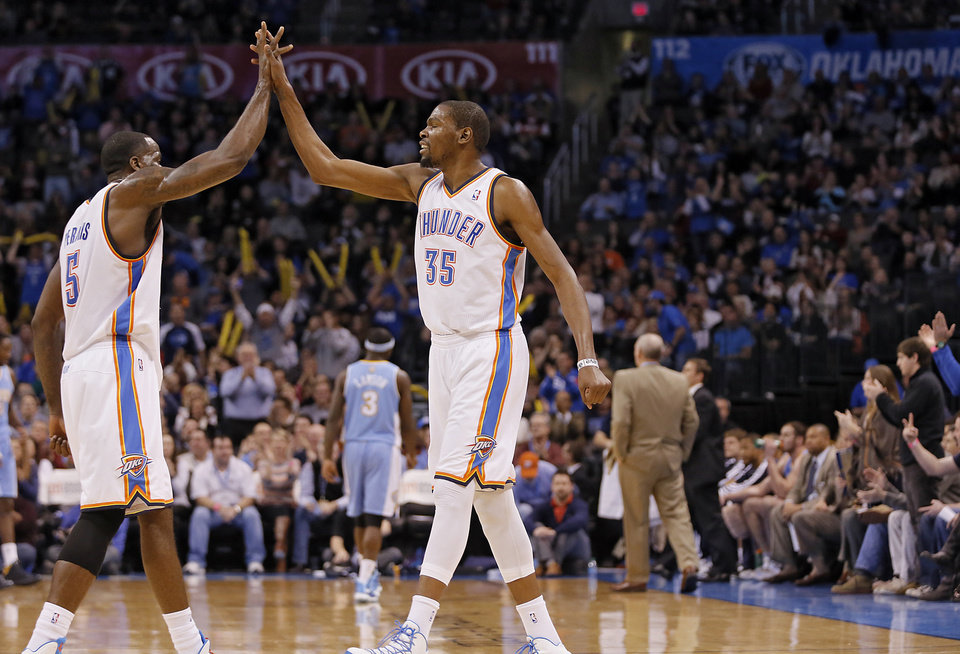 Oklahoma City\'s Kendrick Perkins (5) and Kevin Durant (35) react after a timeout during the NBA basketball game between the Oklahoma City Thunder and the Denver Nuggets at the Chesapeake Energy Arena on Wednesday, Jan. 16, 2013, in Oklahoma City, Okla. Photo by Chris Landsberger, The Oklahoman