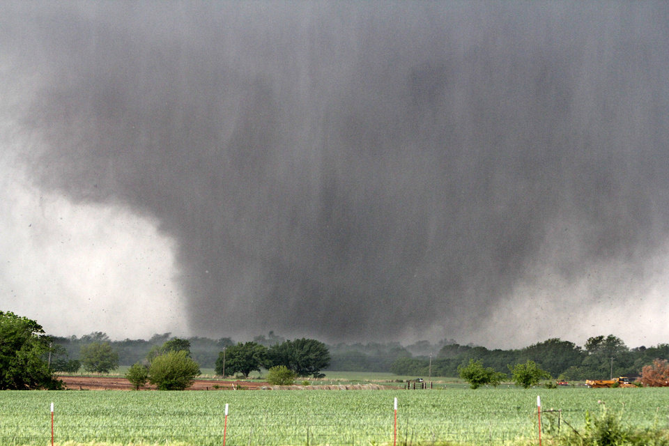Photo -  A tornado passes across south OKC Oklahoma City, OK, Monday, May 20, 2013, By Paul Hellstern, The Oklahoman