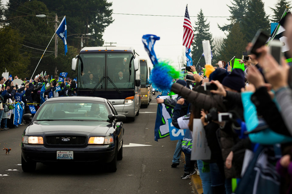 Photo - Seahawks team buses make their way to the airport en route to New York for Super Bowl XLVIII, Sunday, Jan. 26, 2014, in SeaTac, Wash. (AP Photo/seattlepi.com, Jordan Stead)