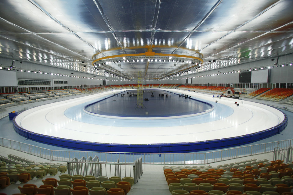 Photo - FOR STORY RUSSIA SOCHI YEAR TO GO - In this photo dated Wednesday, Jan. 30, 2013,  The  inside view of the Adler-arena speed skating venue at the Russian Black Sea resort of Sochi, with just one year till the opening ceremony of the winter Olympic 2014 Sochi Games.  The Black Sea resort of Sochi is a vast construction site sprawling for nearly 40 kilometers (25 miles) along the coast and 50 kilometers (30 miles) up into the mountains, with no escape from the clang and clatter of the construction works, the drilling, jack-hammering and mixing of cement. (AP Photo/Igor Yakunin)