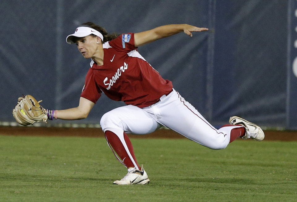 Photo - OU's Callie Parsons makes the catch for an out in the third inning of a Women's College World Series game between at ASA Hall of Fame Stadium in Oklahoma City Thursday, May 29, 2014. Photo by Bryan Terry, The Oklahoman