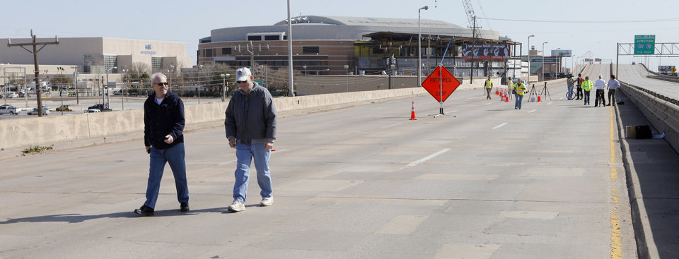 Gary Wilson, Warr Acres, and Jim Pattillo, Bethany, walking in the westbound lanes of the old I-40 Crosstown in Oklahoma City Wednesday, Feb. 29, 2012. The Oklahoma Department of Transportation let folks park and walk a section of the former highway in downtown Oklahoma City. Photo by Paul B. Southerland, The Oklahoman