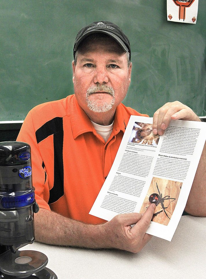 Ray Ridlen, Oklahoma State University extension agent, talks about the explosion of black widows. Photo by David McDaniel, The Oklahoman