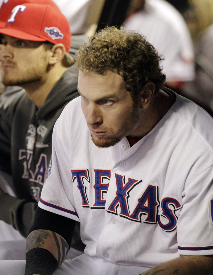 Photo -   Texas Rangers center fielder Josh Hamilton, right, watches from the dugout during the seventh inning of an American League wild-card playoff baseball game against the Baltimore Orioles on Friday, Oct. 5, 2012, in Arlington, Texas. (AP Photo/Tony Gutierrez)