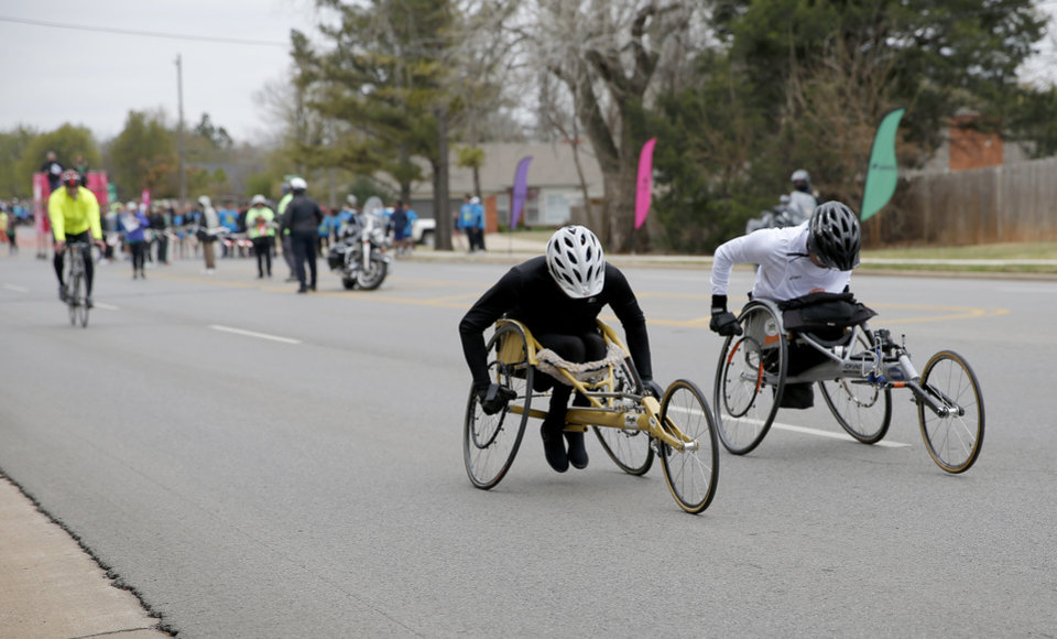 Photo -  Wheelchair competitors are in the race Sunday during the Redbud Classic. [Photo by Sarah Phipps, The Oklahoman]