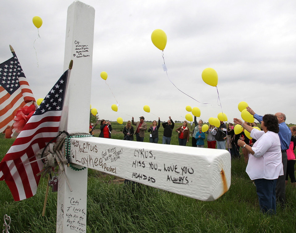 Photo - Balloons are released in memory of those who died a year ago in the West Fertilizer Plant explosion on Thursday, April 17, 2014.  Fifteen people were killed, including 12 volunteer firefighters and others responding to the fire, and more than 200 were injured. The  (AP Photo/Waco Tribune Herald, Jerry Larson)
