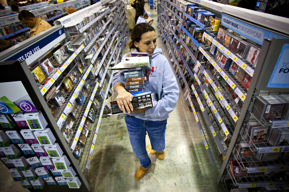 Photo - Tonya Thomas, of Russellville, Ky., makes her way Nov. 23 through the aisles at Best Buy in Bowling Green, Ky.  AP Photo