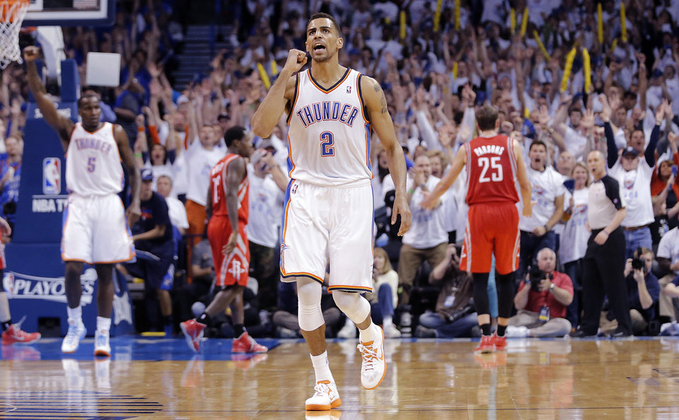Oklahoma City's Thabo Sefolosha (2) reacts after hitting a three point shot late in the game during Game 2 in the first round of the NBA playoffs between the Oklahoma City Thunder and the Houston Rockets at Chesapeake Energy Arena in Oklahoma City, Wednesday, April 24, 2013. Photo by Chris Landsberger, The Oklahoman