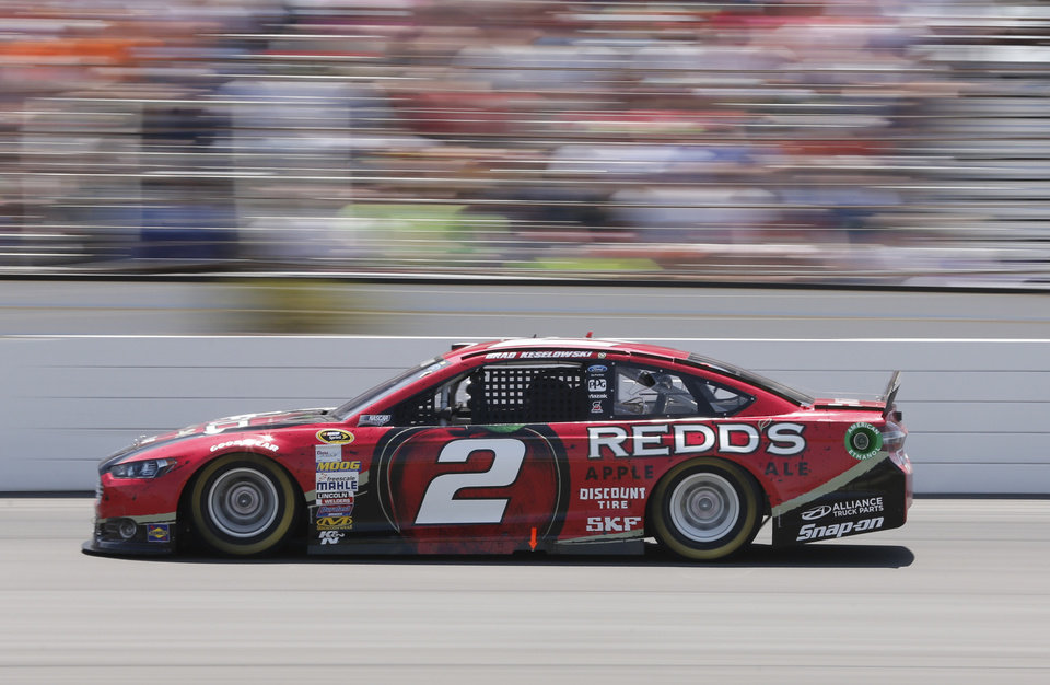 Photo - Brad Keselowski (2) races to a second-place finish in the NASCAR Sprint Cup Series Pocono 400 auto race at Pocono Raceway on Sunday, June 8, 2014, in Long Pond, Pa. (AP Photo/Mike Groll)