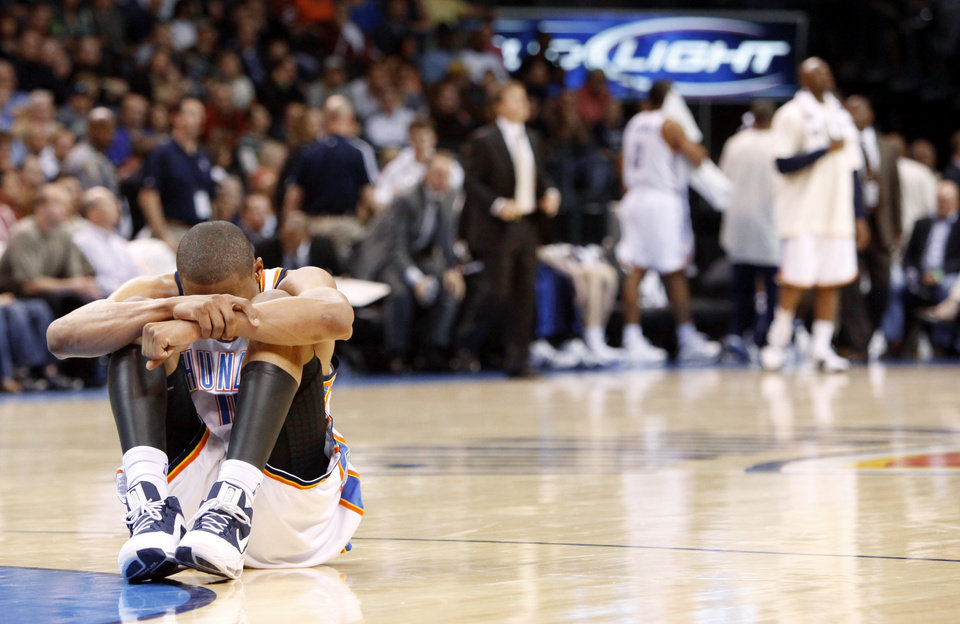 Photo - Oklahoma City's Russell Westbrook sits on the floor after a play during the NBA basketball game between the Oklahoma City Thunder and the Portland Trail Blazers at the Ford Center in Oklahoma City, Friday, April 3, 2009.   Photo by Bryan Terry, The Oklahoman ORG XMIT: KOD