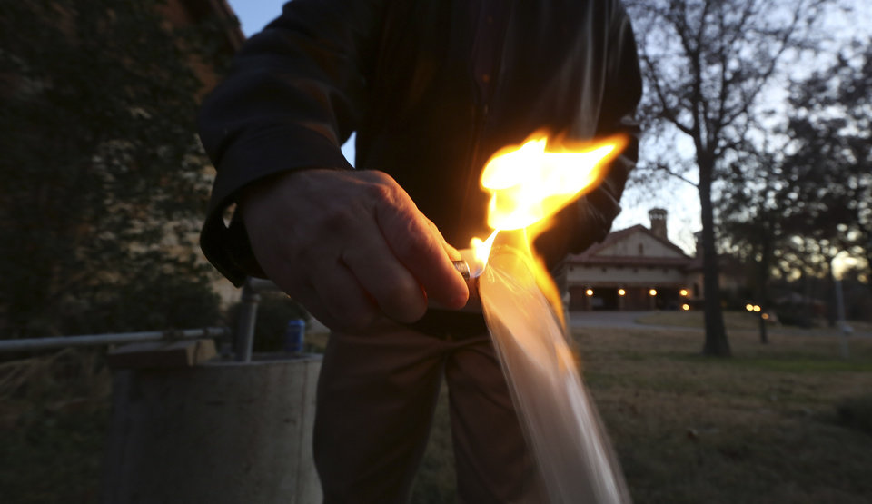 "Photo - In this Nov. 27, 2012 photo, water flowing from Steve Lipsky's well ignites when he puts a flame to the well spigot outside his family's home in rural Parker County near Weatherford, Texas. The U.S. Environmental Protection Agency had evidence a gas company's drilling operation contaminated Lipsky's drinking water with explosive methane, and possibly cancer-causing chemicals, but withdrew its enforcement action, leaving the family with no useable water supply, according to a report obtained by The Associated Press. The EPA's decision to roll back its initial claim that hydraulic fracturing, or ""fracking,"" operations had contaminated the water is the latest case in which the federal agency initially linked drilling to water contamination and then softened its position, drawing criticism from Republicans and industry officials who insisted they proved the agency was inefficient and too quick to draw conclusions. (AP Photo/LM Otero)"