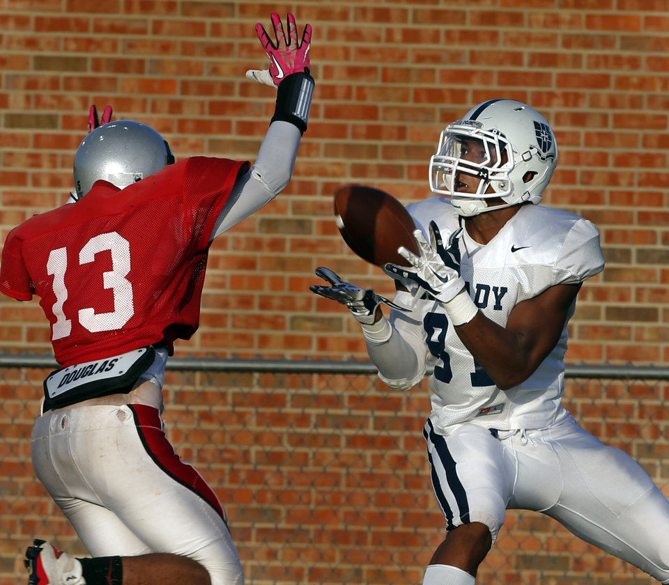 Photo - Casady's Denver Johnson catches a pass and runs to the end zone against Grant High School during at a high school football scrimmage at Casady School in Oklahoma City, Okla., on Friday, Aug. 22, 2014. Photo by Steve Sisney, The Oklahoman