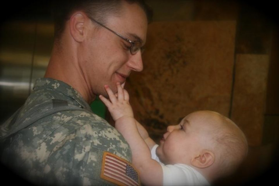 Conner Lee Jarose (8 months old) gets reacquainted with Dad, E-4 Specialist Daniel Lee Jarose with Delta 1-14FA, who has returned from Iraq for an 18-day leave.  Conner was just three weeks old when Daddy was deployed.<br/><b>Community Photo By:</b> Carol P. Wight<br/><b>Submitted By:</b> Carol, Bethany