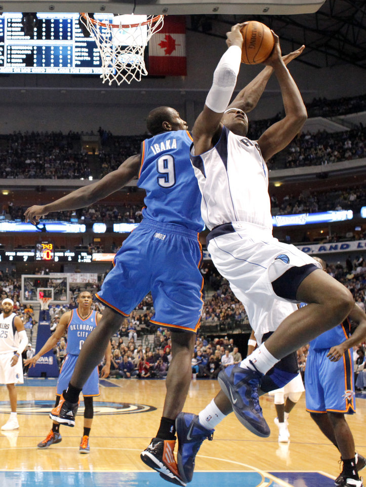 Photo - Oklahoma City's Serge Ibaka (9) tries to block Dallas' Brendan Haywood (33)  during the pre season NBA game between the Dallas Mavericks and the Oklahoma City Thunder at the American Airlines Center in Dallas, Sunday, Dec. 18, 2011. Photo by Sarah Phipps, The Oklahoman