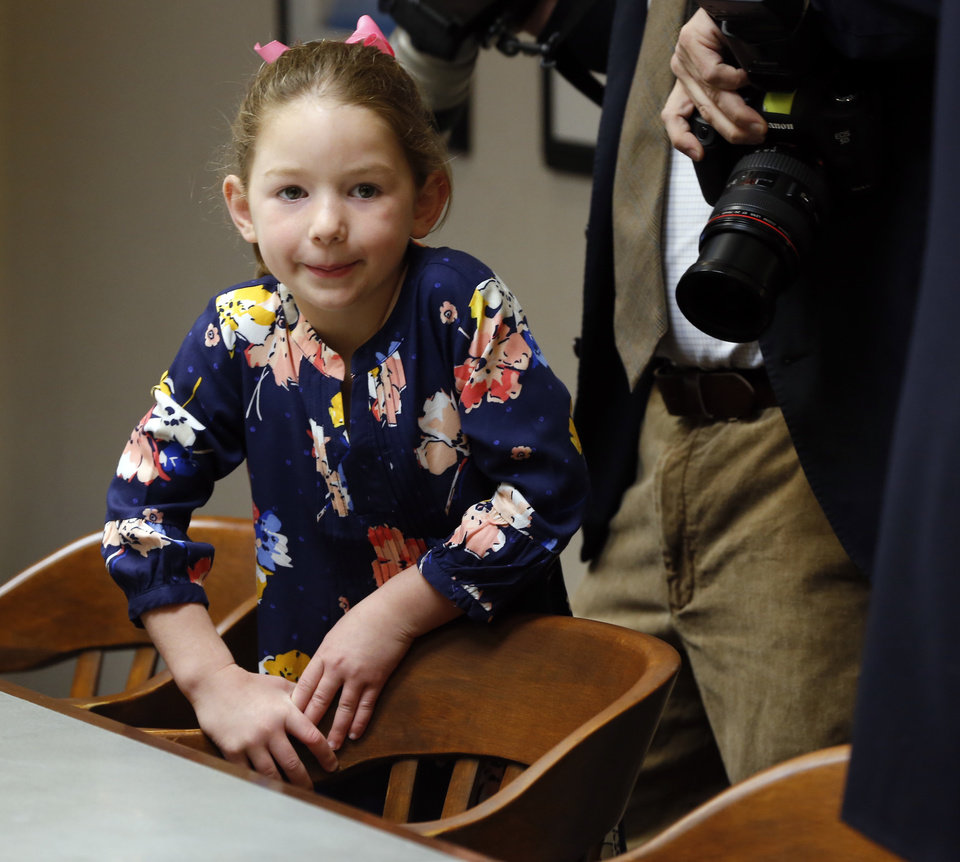 Photo - Mayor David Holt's daughter Maggie, 6, stands in the Mayor's Conference room following the swearing in ceremony for her dad on Tuesday, April 10, 2018 in Oklahoma City, Okla.  Photo by Steve Sisney, The Oklahoman