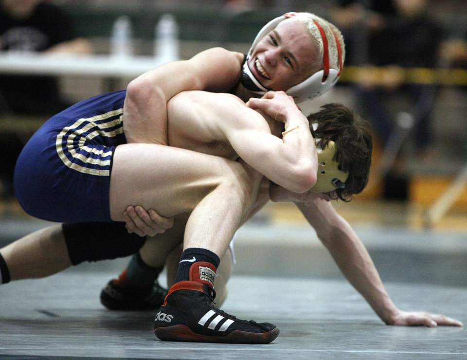 Southmoore's Zac Damico wrestles Yukon's Boo Lewallen in the 113-pound class during the 6A West regional of state wrestling at Edmond Santa Fe High School in Edmond, Okla., Saturday, Feb. 18, 2012. Photo by Sarah Phipps, The Oklahoman