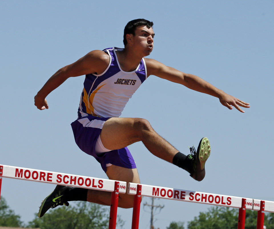 Photo - John Pruitt, Westville, wins the boys 3A 300 meter hurdles at the Class 3A-4A state track meet at Moore Stadium on Saturday, May 10, 2014 in Moore, Okla.  Photo by Steve Sisney, The Oklahoman