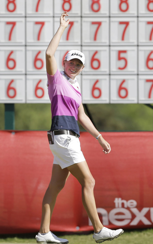 Photo - Stacy Lewis waves after winning the North Texas LPGA Shootout golf tournament at Las Colinas Country Club in Irving, Texas, Sunday, May 4, 2014. (AP Photo/LM Otero)
