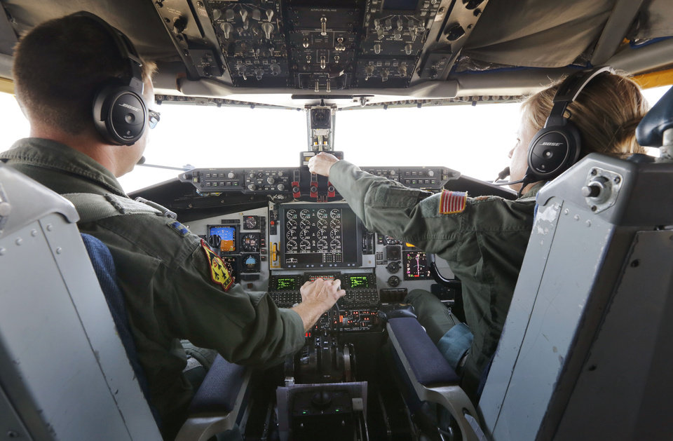 Photo -  Capt. Dan Shaheen and Maj. Jenette Milburn pilot a KC-135 Stratotanker during a practice refueling flight. During the flight, the tanker rendezvoused with a B-52 Stratofortress from Barksdale Air Force Base, which is near Bossier City, La. [Photo by Paul Hellstern, The Oklahoman]