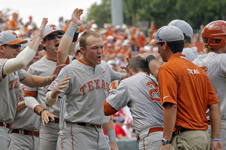 Photo - Texas's Mark Payton (2) celebrates with his teammates after hitting a home run against Houston in the first inning of an NCAA college baseball tournament super regional game in  Austin, Texas, Friday, June 6, 2014.  (AP Photo/Michael Thomas)