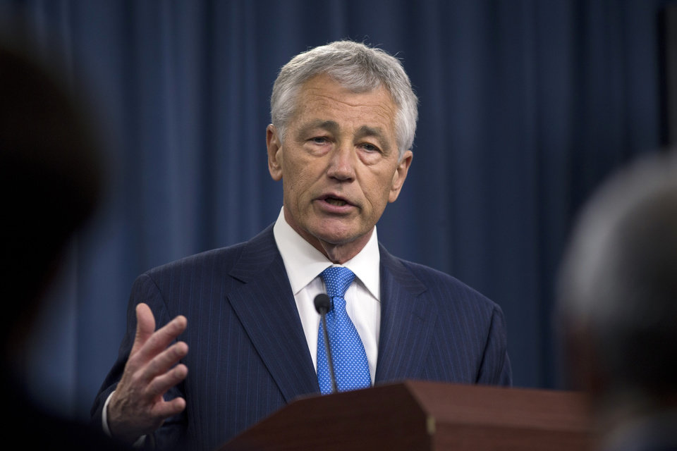 Photo - New Defense Secretary Chuck Hagel gestures as he speaks at a news conference regarding the automatic spending cuts, Friday, March 1, 2013, at the Pentagon. (AP Photo/Carolyn Kaster)