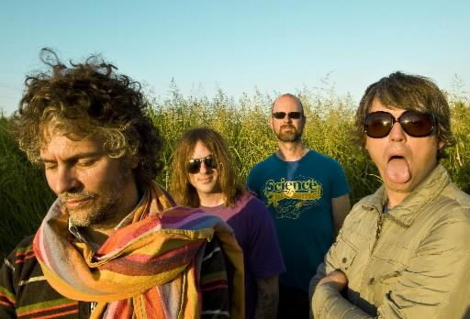 Photo - Wayne Coyne, Kliph Scurlock, Michael Ivins, Steven Drozd, from left, are the  Flaming  Lips. PHOTO BY MICHELLE MARTIN-COYNE