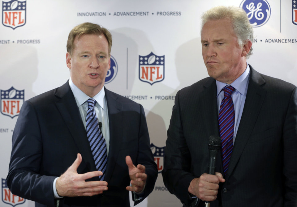 Photo - General Electric Chairman and CEO Jeff Immelt, right, listens as NFL Commissioner Roger Goodell talks with reporters at an NFL football news conference in New York, Monday, March 11, 2013. GE is partnering with the NFL, the U.S. Military and others to further research on head injuries.  (AP Photo/Seth Wenig)