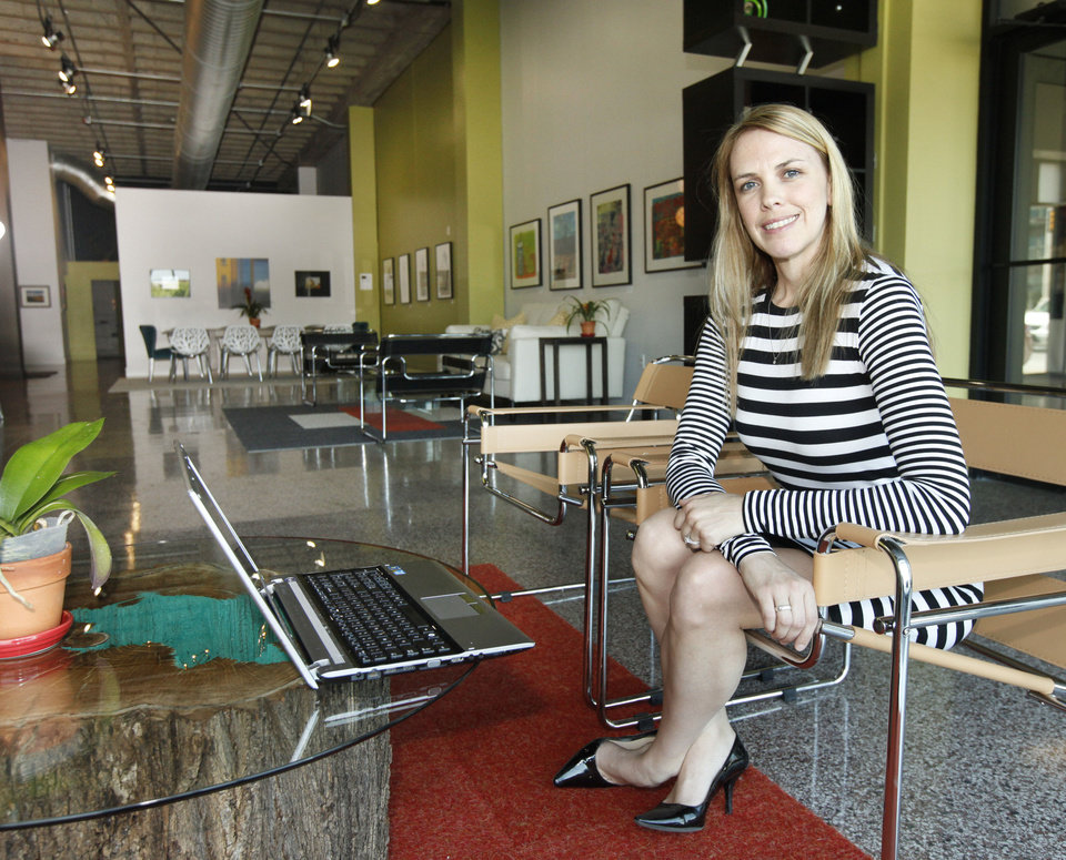 Photo - Sarah Bytyqi, founder and managing broker of Verbode, shows the casual and collaborative work space for agents and clients downtown at 415 N Broadway, Suite 101. Photo by Paul Hellstern, The Oklahoman  PAUL HELLSTERN