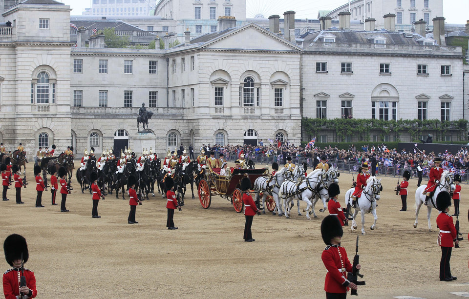 Photo - Britain's Prince William and his wife Kate, Duchess of Cambridge pass through Horse Guards Parade, enroute to Buckingham Palace following their marriage at Westminster Abbey  in London, Friday, April 29, 2011. (AP Photo/Sang Tan, Pool) ORG XMIT: LST115