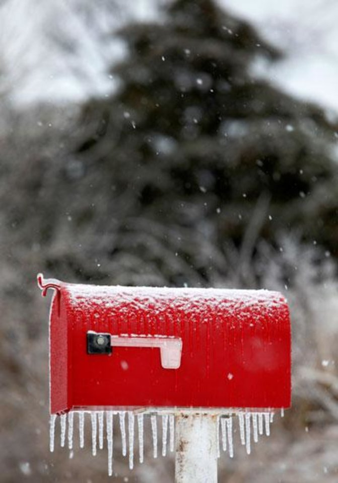 Photo -  A mail box is covered in ice on Pine road in Logan County, Okla., January 29, 2010. Photo by Steve Gooch, The Oklahoman