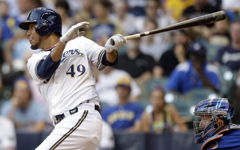 Milwaukee Brewers' Yovani Gallardo watches his double against the New York Mets during the fourth inning of a baseball game on Saturday, July 6, 2013, in Milwaukee. (AP Photo/Jeffrey Phelps)